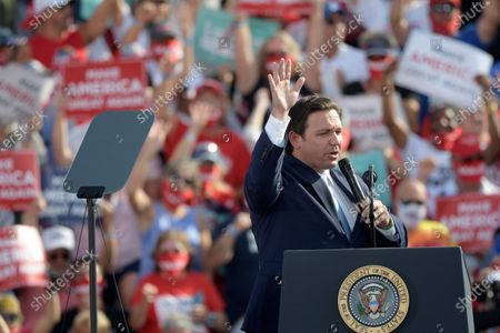 Stock Photo of Florida Gov. Ron DeSantis speaks before President Donald Trump during a campaign rally at the Ocala International Airport, in Ocala, Fla