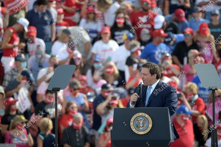 Florida Gov. Ron DeSantis speaks before President Donald Trump during a campaign rally at the Ocala International Airport, in Ocala, Fla
