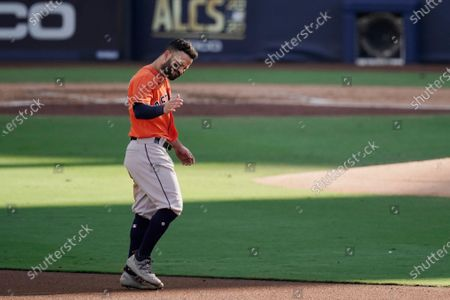 Houston Astros second baseman Jose Altuve walks to second base after grounding out to end the third inning in Game 6 of a baseball American League Championship Series against the Tampa Bay Rays, in San Diego