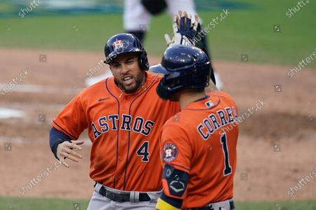 Houston Astros George Springer is congratulated by Carlos Correa after scoring on a single by Jose Altuve against the Tampa Bay Rays during the fifth inning in Game 6 of a baseball American League Championship Series, in San Diego