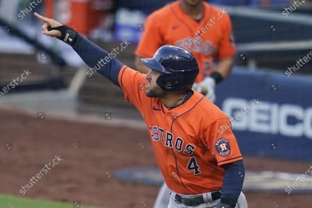 Houston Astros George Springer reacts after scoring on a single by Jose Altuve against the Tampa Bay Rays during the fifth inning in Game 6 of a baseball American League Championship Series, in San Diego