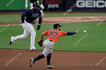 Houston Astros second baseman Jose Altuve throws the ball to Houston Astros Carlos Correa to force out Tampa Bay Rays' Yandy Diaz during the sixth inning in Game 6 of a baseball American League Championship Series, in San Diego