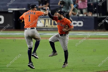 Houston Astros Carlos Correa (1) celebrates with Jose Altuve after winning Game 6 of a baseball American League Championship Series, in San Diego. The Astros defeated the Rays 7-4 to tie the series 3-3