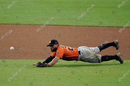 Houston Astros second baseman Jose Altuve misses a single hit by Tampa Bay Rays' Yoshitomo Tsutsugo during the ninth inning in Game 6 of a baseball American League Championship Series, in San Diego