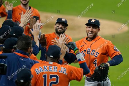 Houston Astros George Springer (4) and Jose Altuve celebrates with his teammates after winning Game 6 of a baseball American League Championship Series against the Houston Astros, in San Diego. The Astros defeated the Rays 7-4 to tie the series 3-3