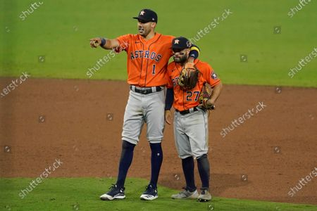 Houston Astros Carlos Correa (1) and Jose Altuve stand in the infield while waiting for a video ruling during the ninth inning in Game 6 of a baseball American League Championship Series against the Tampa Bay Rays, in San Diego. The Astros defeated the Rays 7-4 to tie the series 3-3
