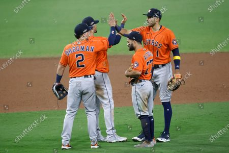 Houston Astros first baseman Yuli Gurriel (2-L), Houston Astros third baseman Alex Bregman (L), Houston Astros second baseman Jose Altuve (2-R), and Houston Astros shortstop Carlos Correa (R) celebrate at the conclusion of the MLB American League Championship Series playoff baseball game six between the Houston Astros and Tampa Bay Rays at Petco Park in San Diego, California, USA, 16 October 2020.