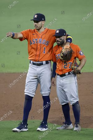 Houston Astros shortstop Carlos Correa (L), and Houston Astros second baseman Jose Altuve (R) wait for the replay in the final out of the MLB American League Championship Series playoff baseball game six between the Houston Astros and Tampa Bay Rays at Petco Park in San Diego, California, USA, 16 October 2020.