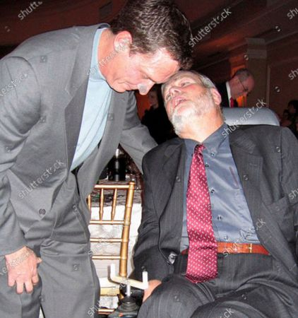 Stock Image of In this 2005 photo, Christopher Pendergast meets with former Mets and Yankees pitcher David Cone at a fundraising gala organized students in the school district where he taught. Pendergast, a suburban New York teacher who turned a dreaded Lou Gehrig's Disease diagnosis into a decades-long campaign to raise awareness and fund research, died from the illness on . He was 71. (AP Photo/Michael Sisak
