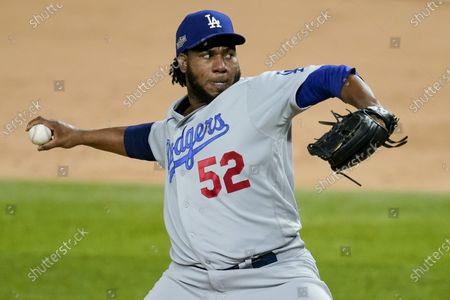 Los Angeles Dodgers relief pitcher Pedro Baez throws against the Atlanta Braves during the sixth inning in Game 5 of a baseball National League Championship Series, in Arlington, Texas