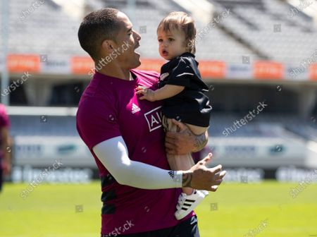 New Zealand's Aaron Smith holds his son Luka during the All Blacks captains run at Eden Park ahead of the second Bledisloe Rugby test against Australia, in Auckland, New Zealand, . New Zealand plays the Wallabies here Sunday Oct 18 in the second of four Bledisloe tests