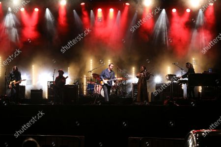 Jason Isbell, Jimbo Hart, Sadler Vaden, Amanda Shires, Chad Gamble and Derrick DeBorja with Jason Isbell and The 400 Unit performs during the Live From the Drive-In concert series at the Ameris Bank Amphitheatre, in Atlanta