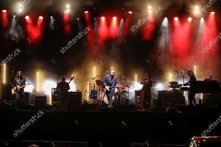 Stock Photo of Jason Isbell, Jimbo Hart, Sadler Vaden, Amanda Shires, Chad Gamble and Derrick DeBorja with Jason Isbell and The 400 Unit performs during the Live From the Drive-In concert series at the Ameris Bank Amphitheatre, in Atlanta