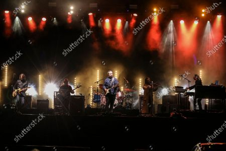 Stock Picture of Jason Isbell, Jimbo Hart, Sadler Vaden, Amanda Shires, Chad Gamble and Derrick DeBorja with Jason Isbell and The 400 Unit performs during the Live From the Drive-In concert series at the Ameris Bank Amphitheatre, in Atlanta