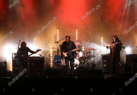 Stock Image of Jason Isbell, Jimbo Hart, Sadler Vaden, Amanda Shires, Chad Gamble and Derrick DeBorja with Jason Isbell and The 400 Unit performs during the Live From the Drive-In concert series at the Ameris Bank Amphitheatre, in Atlanta