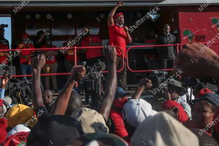 EFF (Economic Freedom Fighters) leader Julius Malema, speaking outside the magistrates court during the demonstration. A tense standoff between white farmers and Black activists gripped the South African town of Senekal, as two men accused of killing a white farm manager were to appear in court. More than 100 police patrolled the area in front of the courthouse in the Free State province and used barbed wire to separate the rival groups.