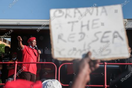 EFF (Economic Freedom Fighters) leader Julius Malema speaking to protesters outside the magistrates court during the demonstration. A tense standoff between white farmers and Black activists gripped the South African town of Senekal, as two men accused of killing a white farm manager were to appear in court. More than 100 police patrolled the area in front of the courthouse in the Free State province and used barbed wire to separate the rival groups.