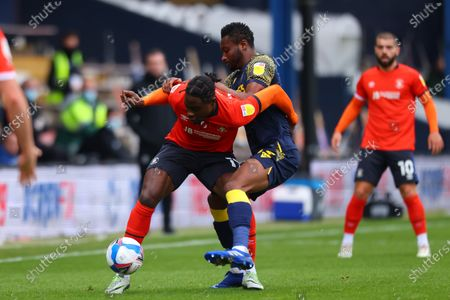Pelly Ruddock of Luton Town competes for the ball with Mikel John Obi of Stoke City; Kenilworth Road, Luton, Bedfordshire, England; English Football League Championship Football, Luton Town versus Stoke City.