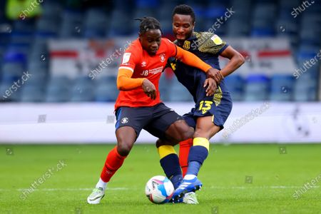 Mikel John Obi of Stoke City challenges Pelly Ruddock of Luton Town; Kenilworth Road, Luton, Bedfordshire, England; English Football League Championship Football, Luton Town versus Stoke City.