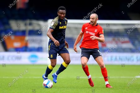 Mikel John Obi of Stoke City under pressure from Danny Hylton of Luton Town; Kenilworth Road, Luton, Bedfordshire, England; English Football League Championship Football, Luton Town versus Stoke City.