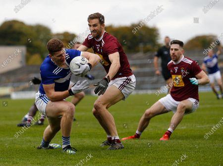 Evan O'Carroll (Laois) holds on to the ball under pressure from Kevin Maguire (Westmeath); TEG Cusack Park, Mullingar, Westmeath, Ireland; Allianz Football Division 2 Gaelic Football, Westmeath versus Laois.