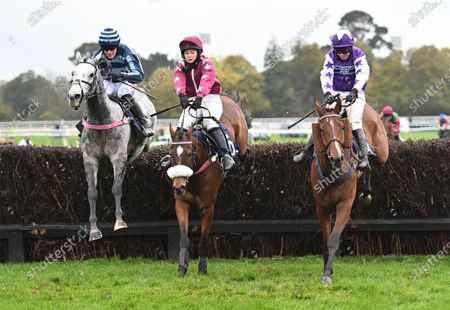 (L) Danseur du Large (Nick Scholfield) takes the last before going on to  cross the line first from (C) Follow The Paint (Tabitha Worsley) and (R) Overworkdunderpaid (Kielan Woods) in The Hotsr Shares Available With Gary Moore Handicap Steeple Chase. Photo © Hugh Routledge.