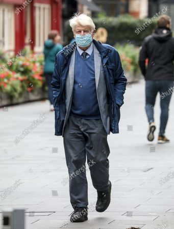 Stanley Johnson, the father of British Prime Minister Boris Johnson wearing a face mask is spotted out and about in London.
