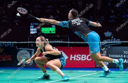 Chris Adcock (R) and Gabrielle Adcock of England in action during their mixed doubles semifinal match against Julien Mario and Lea Palermo of France. at the Danisa Denmark Open Badminton tournament in Odense, Denmark, 17 October 2020.