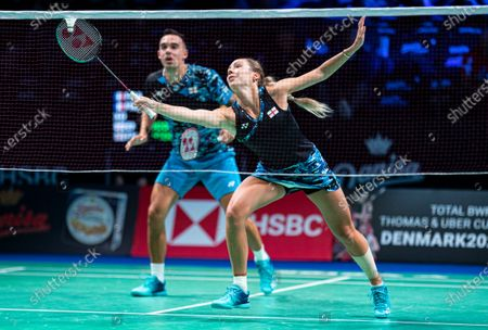 Stock Picture of Chris Adcock (L) and Gabrielle Adcock of England in action during their mixed doubles semifinal match against Julien Mario and Lea Palermo of France. at the Danisa Denmark Open Badminton tournament in Odense, Denmark, 17 October 2020.