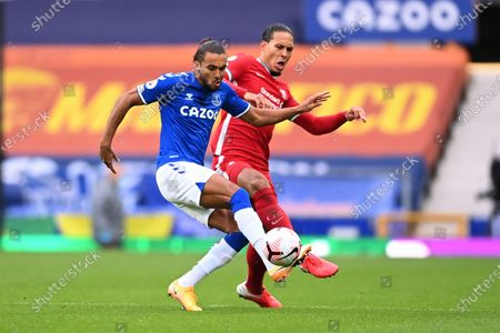 Everton's Dominic Calvert-Lewin, left, competes for the ball with Liverpool's Virgil van Dijk during the English Premier League soccer match between Everton and Liverpool at Goodison Park stadium, in Liverpool, England