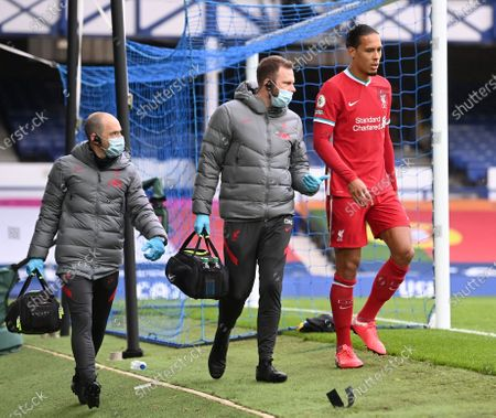 Virgil van Dijk of Liverpool reacts as he leaves the pitch during the English Premier League match between Everton and Liverpool in Liverpool, Britain, 17 October 2020.