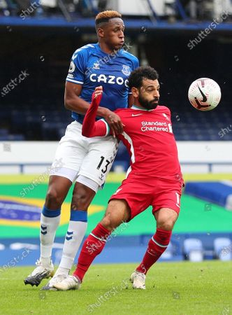 Yerry Mina of Everton (L) in action against Mohamed Salah of Liverpool (R) during the English Premier League match between Everton and Liverpool in Liverpool, Britain, 17 October 2020.