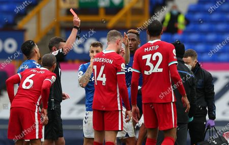 Referee Micheal Oliver shows a red card to Richarlison of Everton (not seen) during the English Premier League match between Everton and Liverpool in Liverpool, Britain, 17 October 2020.