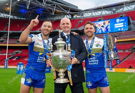Leeds's captain Luke Gale with head coach Richard Agar and the Lance Todd Trophy winning man of the match Richie Myler after their side defeated Salford in the Coral Challenge Cup final.