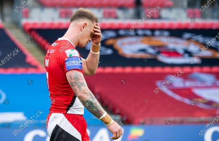 Salford's Kevin Brown dejected after his side's defeat to Leeds in the Coral Challenge Cup final.