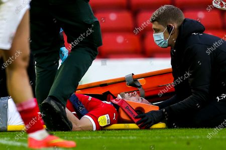 Luke Thomas of Barnsley recieves treatment for an injury