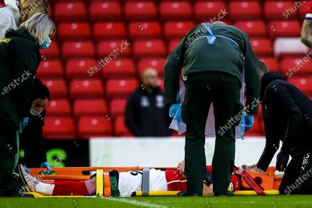 Stock Image of Luke Thomas of Barnsley recieves treatment for an injury