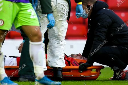 Stock Photo of Luke Thomas of Barnsley recieves treatment for an injury