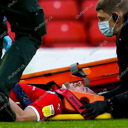 Stock Picture of Luke Thomas of Barnsley recieves treatment for an injury