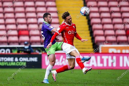 Tommy Rowe of Bristol City takes on Jordan Williams of Barnsley