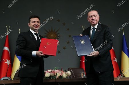 Turkish President Recep Tayyip Erdogan (R) and Ukrainian President Volodymyr Zelensky present documents in Istanbul, Turkey, on Oct. 16, 2020. Erdogan and Zelensky on Friday pledged to enhance cooperation in a wide range of areas amid the COVID-19 pandemic.