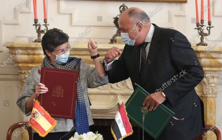 Egyptian Foreign Minister Sameh Shoukry and Spanish Foreign Minister Arancha Gonzalez Laya bump elbows at the Tahrir Palace in Cairo, Egypt, 17 October 2020. Gonzalez Laya is on a two-day official visit to Egypt.