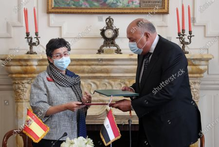 Egyptian Foreign Minister Sameh Shoukry and Spanish Foreign Minister Arancha Gonzalez Laya exchange the signed agreements at the Tahrir Palace in Cairo, Egypt, 17 October 2020. Gonzalez Laya is on a two-day official visit to Egypt.