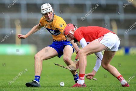 Clare vs Cork. Clare's Niall O'Farrell and Ben O'Connor of Cork