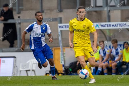 Burton Albion midfielder Ben Fox on the ball chased by Bristol Rovers midfielder Josh Grant (4)  during the EFL Sky Bet League 1 match between Bristol Rovers and Burton Albion at the Memorial Stadium, Bristol