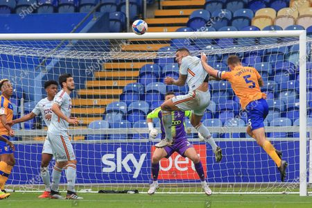Ben Richards-Everton of Bradford City (5) heads the ball clear during the EFL Sky Bet League 2 match between Mansfield Town and Bradford City at the One Call Stadium, Mansfield