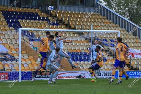 James Perch of Mansfield Town (14) climbs high to head the ball during the EFL Sky Bet League 2 match between Mansfield Town and Bradford City at the One Call Stadium, Mansfield