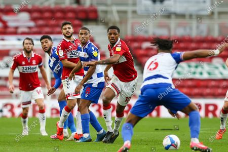 Middlesbrough forward Chuba Akpom (10) Reading midfielder Andy Rinomhota (8) and Middlesbrough midfielder Sam Morsy (5) with eyes on the ball during the EFL Sky Bet Championship match between Middlesbrough and Reading at the Riverside Stadium, Middlesbrough