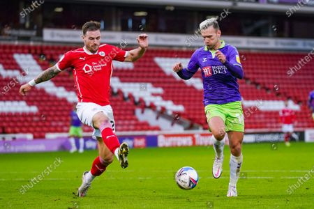 Bristol City forward Andreas Weimann (14) and Barnsley defender Michael Sollbauer (26) in action during the EFL Sky Bet Championship match between Barnsley and Bristol City at Oakwell, Barnsley