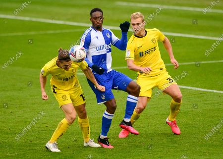 Brandon Hanlan of Bristol Rovers challenges for the ball with Ben Fox of Burton Albion
